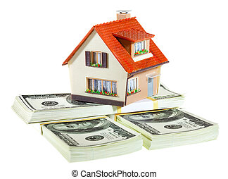 house on packs of banknotes - house on packs on the white
