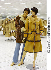 Mannequin in magozine on sale of the winter clothing...