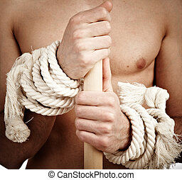 man with a cord on hands...