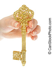 Gold key in hands of the person