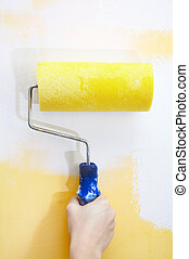 Paint roller on a wall