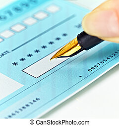 Writing Checks - Close up of a pen and blank check.