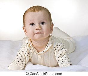Infant lying