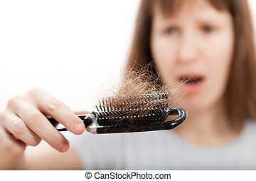 Loss hair comb in women hand - Balding problem women hand...