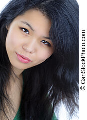 Face - Pretty Asian Young Woman Close Up With Eye Contact