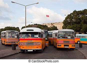 buses at bus terminal at Valletta - Yellow buses at bus...
