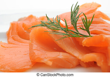 Smoked Salmon - Close-up of smoked salmon served with dill