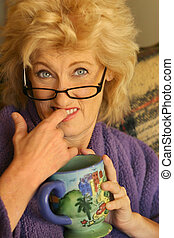 Woman biting figner - Funny portrait of older woman biting...