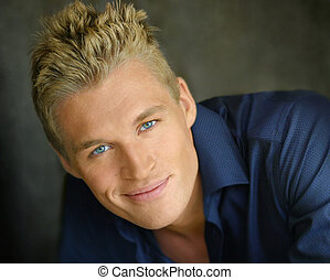 Handsome young man smiling - Portrait of a blond good...