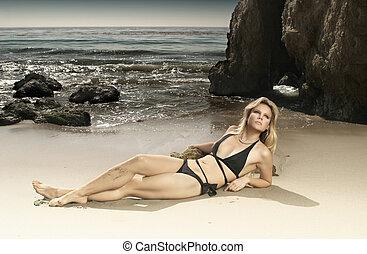 Gorgeous female model in bikini on beach - Horizontal full...