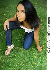 Young female model on grass