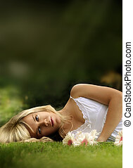 Young model laying down in grass - Beautiful young model...