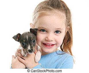 Cute girl holding a puppy - Portrait of an adorable young...