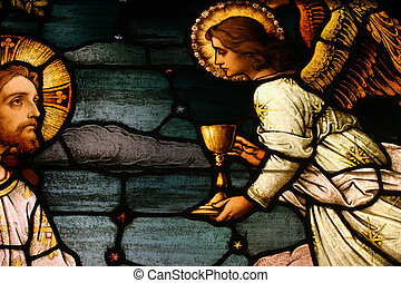 Jesus with Angel - Stained glass depicting Jesus being...