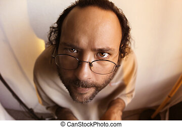 Funny man staring at you - Bearded man in glasses making...