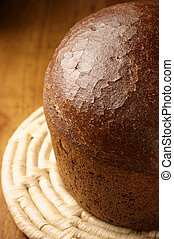 Rye bread - Part of rye bread close-up on wicker saucer