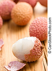 tasty litchi fruit on kitchen table