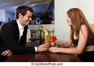 Couple spending time together - Young cheerful couple having...