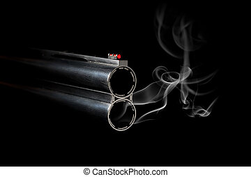 Gun Barrel with Smoke on black background