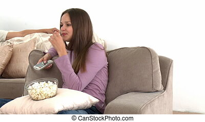 Girl watching tv with popcorn