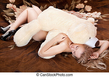 Naked young blonde sleeps