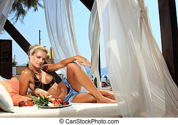 Beautiful young woman by the sea