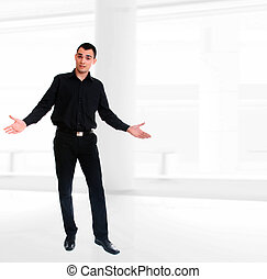 Handsome businessman posing on light business environment