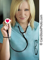 female nurse in love - female nurse with stethoscope in her...