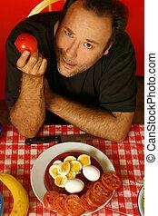 man with tomato