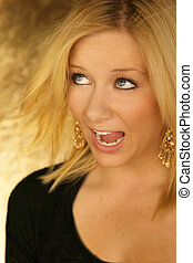 blond young woman with open mouth