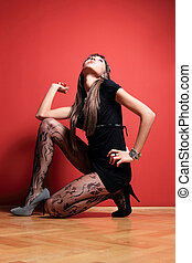 Fashion model on red
