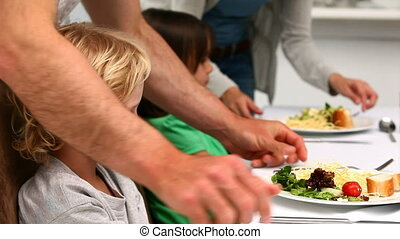 Parents trying to convince kids to eat in the kitchen