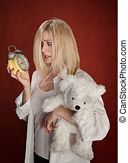 Sleepy Head - Pretty blond woman with bear and clock wakes...