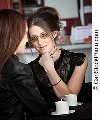 Pretty Listener - A cute young lady listens closely to her...