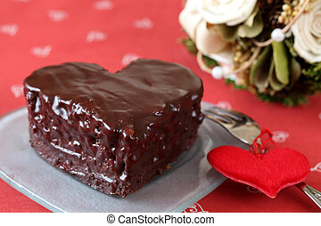 Heart shaped chocolate cake with heart decoration and...