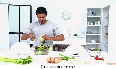 Man preparing a salad for lunch