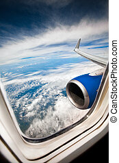 Airplane window - Classic image through aircraft window onto...