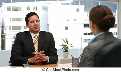 Interview between businesspeople - Interview between a...