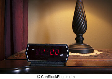 Time - A digital alarm clock displaying 1 pm on the backlit...