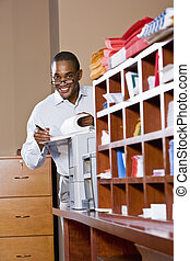 African American businessman reading document - African...