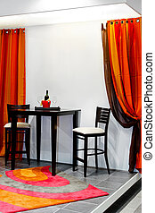Home interior - Two high chairs and table in home