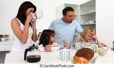 Cute family enjoying breakfast