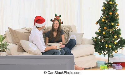 Couple hugging after opening gifts - Couple hugging after...