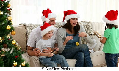 Nice family opening Christmas gifts