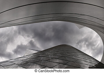 modern architecture - modern metal building with a cloudy...