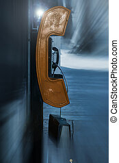 payphone on street - rusted old payphone on a city street...