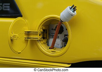 Yellow electric plug - Where the gas tank is usually, there...