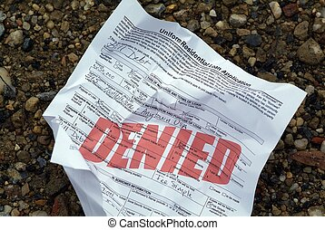 Rejected house loan application - A crumpled up rejected...