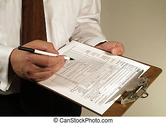 Tax Financial Paperwork Forms - American Business man fills...