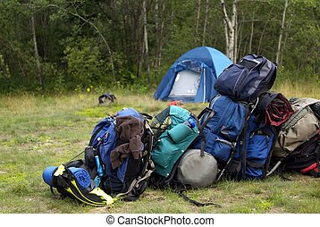 Camping gear packs - Blue Backpacking bags piled up in a...